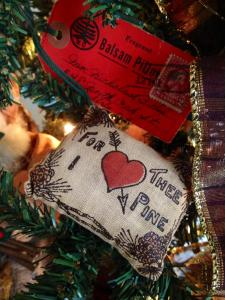 This ornament was sent from my Grandma to my Grandpa while they were young teenagers in love...it is from the 1920's.